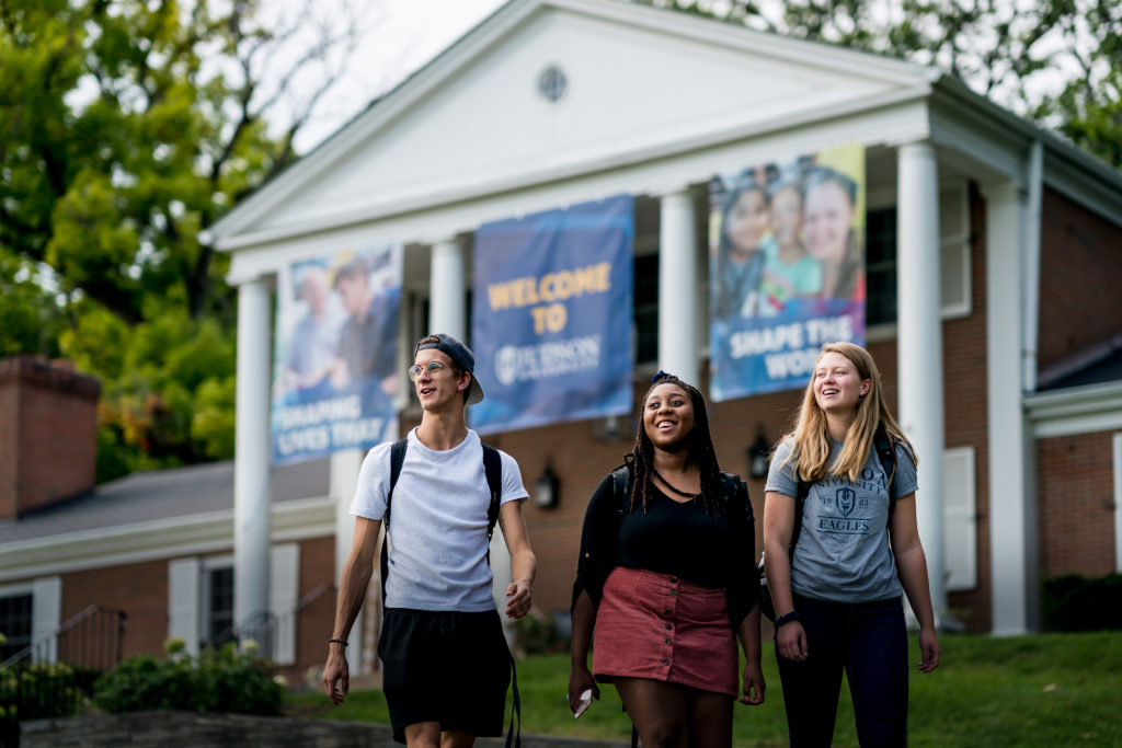 Students walk past the Barton House.