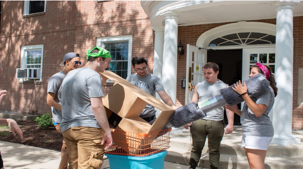 Students helping with move in